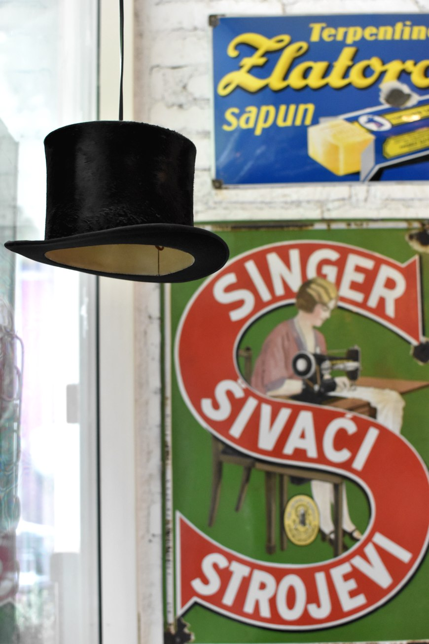 Finjak cafe in Zagreb, retro ads and hat turned into lamps