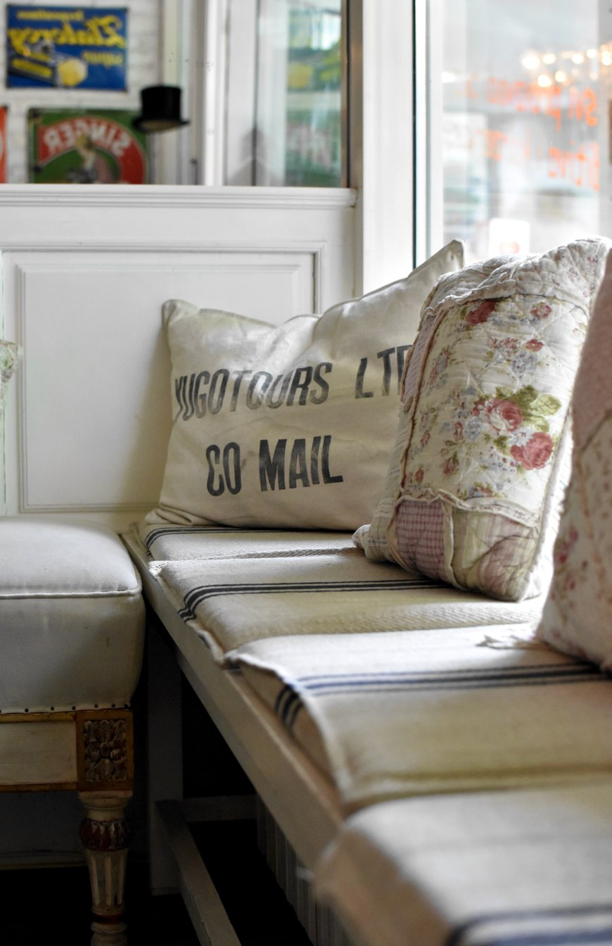 Finjak cafe in Zagreb, decorative pillows made of vintage canvas mail bags